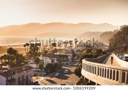 Sunset in Santa Monica, view on beach, pacific ocean and highway, soft focus and low contrast due to rimlight, monochrome vintage