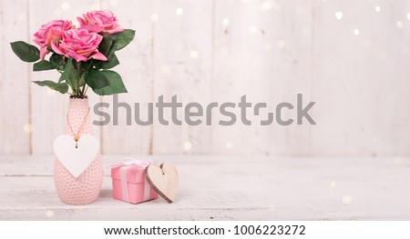 Flowers composition for Valentine's, Mother's or Women's Day. Pink flowers on old white wooden background. Still-life. #1006223272