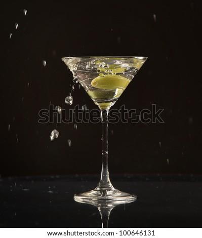 Olive splashing into martini cocktail #100646131
