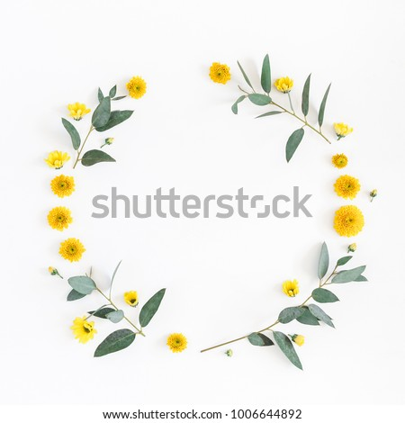 Flowers composition. Wreath made of various yellow flowers and eucalyptus branches on white background. Flat lay, top view, copy space, square. #1006644892