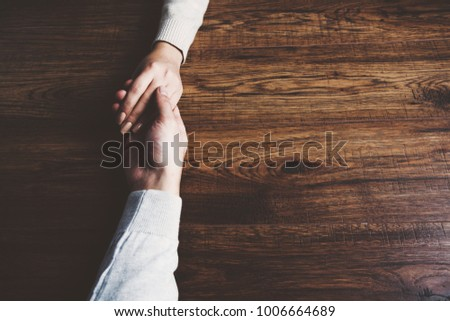 man and a woman holding hands  #1006664689