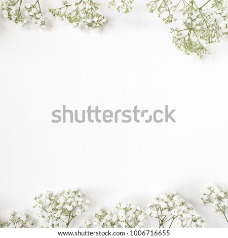 Styled stock photo. Feminine wedding desktop mockup with baby's breath Gypsophila flowers on  white background. Empty space. Floral frame, web banner. Top view. Picture for blog or social media.