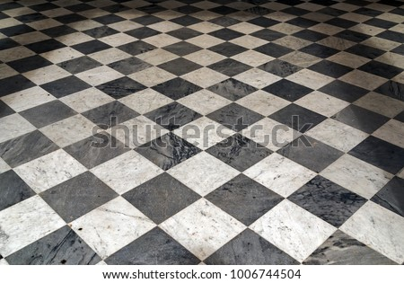 Black and white checkered Perspective view floor grunge tiles marble surface decorative stone interior #1006744504