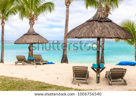 Cabanas with loungers on the beach #1006756540