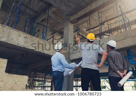 Construction concept of Engineer and Architect working at Construction Site with blue print Royalty-Free Stock Photo #1006780723
