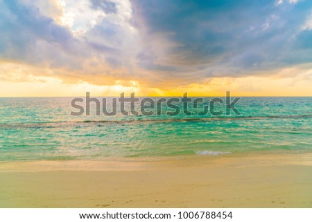 Beautiful sunset with sky over calm sea  in tropical Maldives island #1006788454