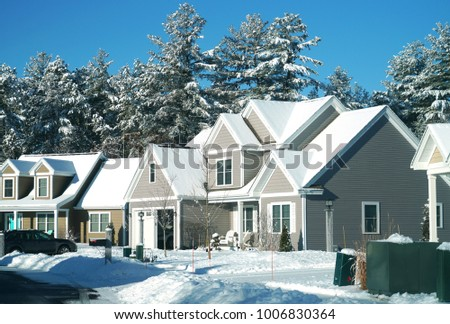 Modern houses in a row in residential area after snow storm #1006830364