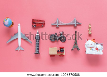 Flat lay aerial image of travel background concept.Table top view of souvenir symbol location or landmark of place for traveler all the world.objects on modern rustic pink paper.mock up & template. #1006870588