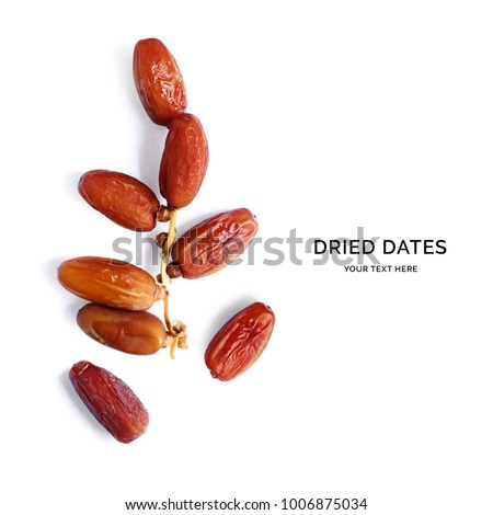 Creative layout made of dried dates on the white background. Flat lay. Food concept. Royalty-Free Stock Photo #1006875034