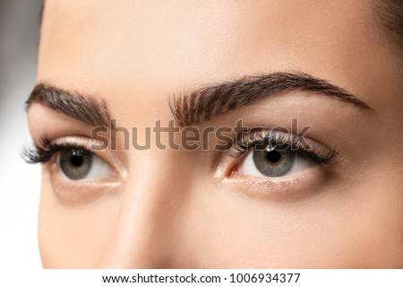 Young woman with beautiful eyebrows, closeup Royalty-Free Stock Photo #1006934377
