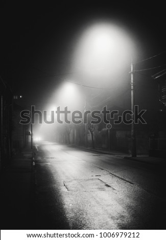 Night scene from small Balkan town, foggy atmosphere.   #1006979212