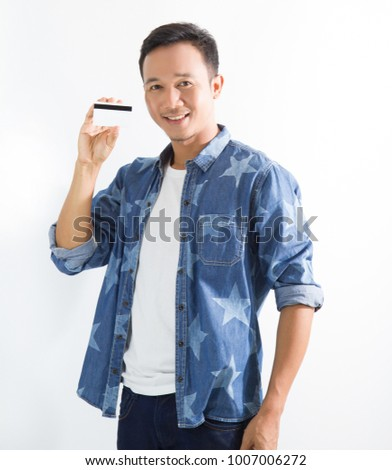 Happy asian man holding  card and smiling shopping concept #1007006272