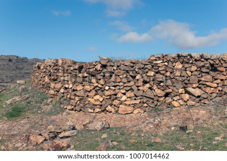 Old stones wall #1007014462