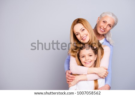Portrait of charming beautiful friendly king supportive cute family members hugging each other isolated on gray background copyspace Royalty-Free Stock Photo #1007058562