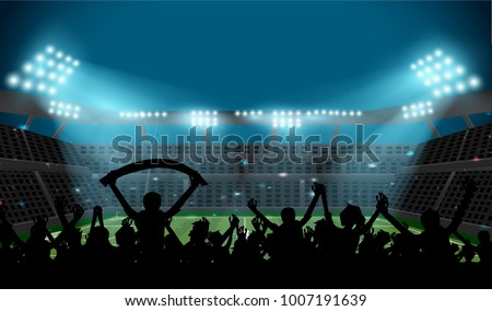 soccer stadium with football field and ball with spotlight at night with glitter light and silhouette fan stand up and hand flag, crowd at seat on soccer stadium,sport concept  #1007191639