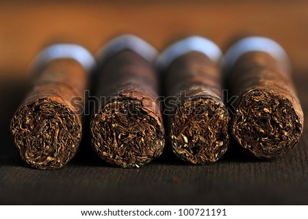 Detailed photo of a cigar front. Very shallow DOF Royalty-Free Stock Photo #100721191