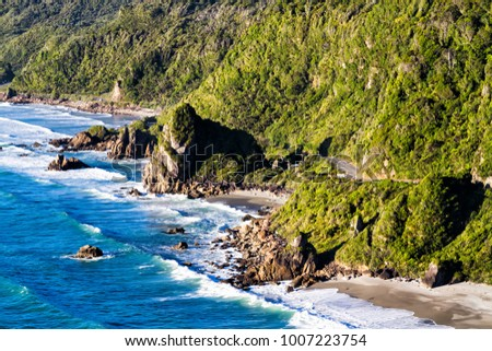New Zealand Coastal Highway: A scenic road winds along the western shore of New Zealand's South Island #1007223754
