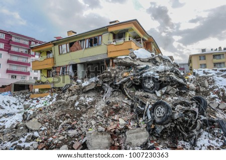 Earthquake and damaged building, Royalty-Free Stock Photo #1007230363