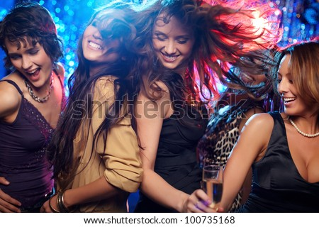 Group shot of young women celebrating their friend'??s forthcoming marriage, hen party Royalty-Free Stock Photo #100735168