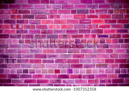 Close-up of brick wall with purple, pink, fuchsia, ultra violet, black color brick background  #1007352358