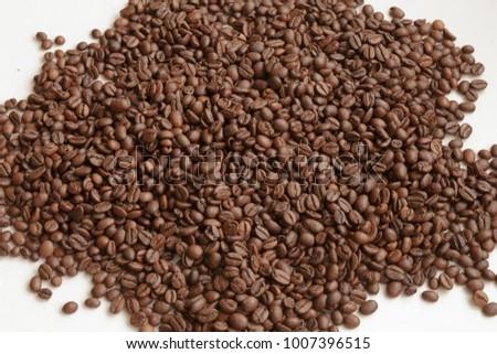 Full Frame Shot of Roasted Coffee Beans. Texture of coffee beans as background. White background. #1007396515