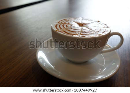 Cup of coffee latte art on wooden background #1007449927