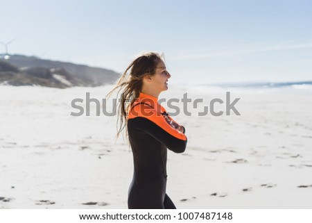 girl surfer in hydro suit #1007487148