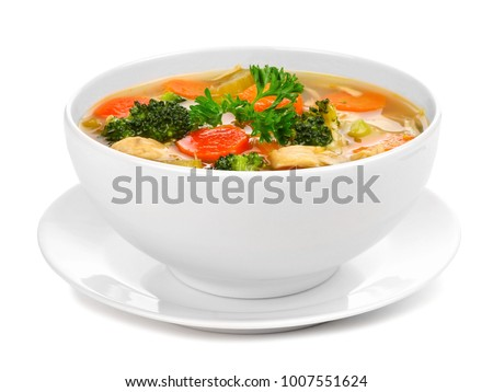 Homemade chicken vegetable soup in a white bowl with saucer. Side view isolated on a white background. #1007551624
