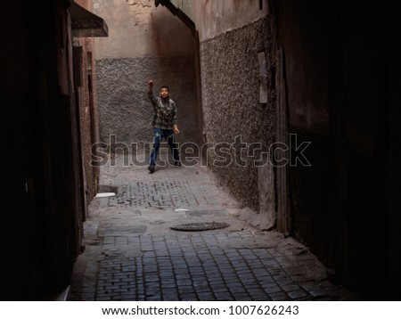Marrakesh, Morocco - January, 10, 2017. Boy in the street in the medina #1007626243