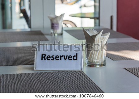 reserved sign on restaurant table #1007646460