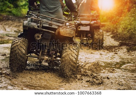 man riding atv vehicle on off road track ,people outdoor sport activitiies theme #1007663368