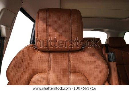 Car leather headrest. Interior detail. Royalty-Free Stock Photo #1007663716