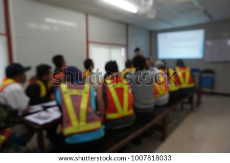 Blurred photograph of on construction site presentation with peoples who wear reflective safety jacket Royalty-Free Stock Photo #1007818033