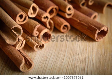 shelves of cinnamon and anise stars in dark backgrounds on a wooden background #1007875069
