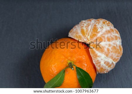 Orange on black background #1007963677