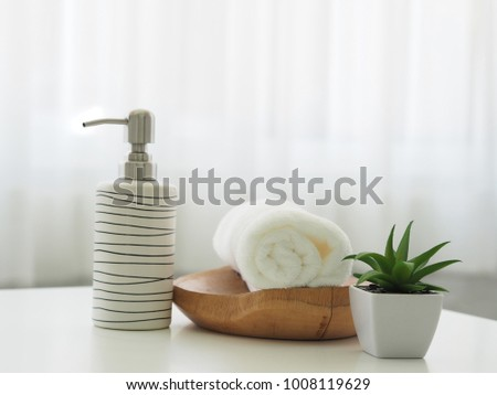 spa towels on white surface #1008119629