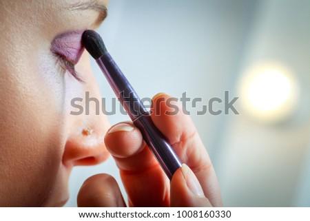 Makeup. Make-up Applying closeup. Eye liner. Cosmetic Eye shadows. Eye line brush for Make up #1008160330