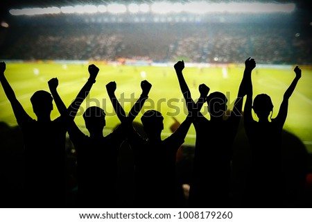 silhouettes of Soccer fans in a match and Spectators at football stadium #1008179260