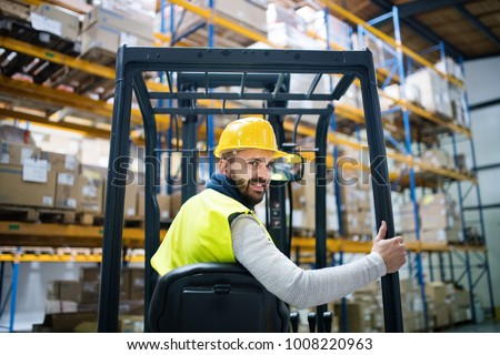 Warehouse man worker with forklift. #1008220963