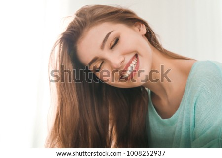 Portrait of beautiful smiling woman at home #1008252937