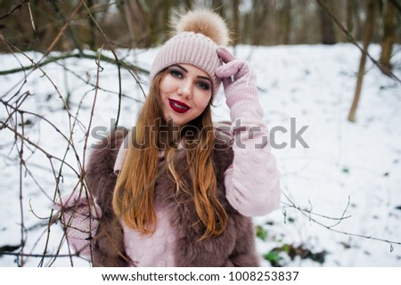 Girl with braces at winter day wear on fur coat and headwear. #1008253837