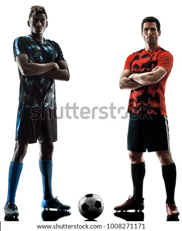 two soccer players men in studio silhouette isolated on white background Royalty-Free Stock Photo #1008271171