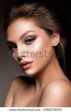 Beauty Woman face Portrait. Beautiful model Girl with Perfect Fresh Clean Skin color lips pink. Brunette long hair. Isolated on beige background #1008278050