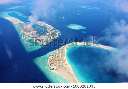 Aerial view of the lagoon of the airport island of Male' in the Maldives #1008281035