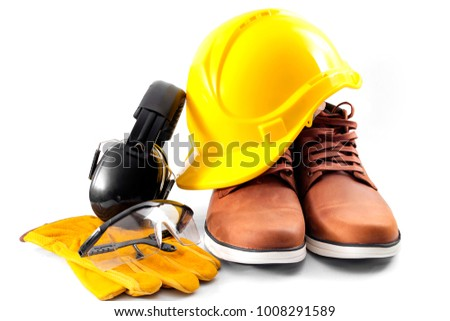 Work safety concept with hard hat, protective gloves, boots, eye safety glasses and hearing protecting noise canceling earmuffs isolated on white background with a clipping path included #1008291589