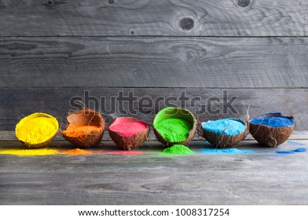 Bright colours in coconut shells for Indian holi festival. Colorful gulal (powder colors) for Happy Holi.