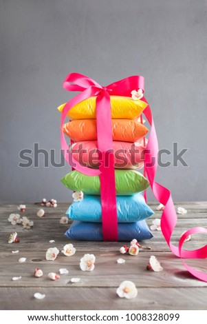 Bright colours in shape of a gift for Indian holi festival. Colorful gulal (powder colors) for Happy Holi.