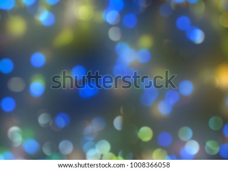Bokeh abstract texture. Colorful. Defocused background. Blurred bright light. Circular points. #1008366058