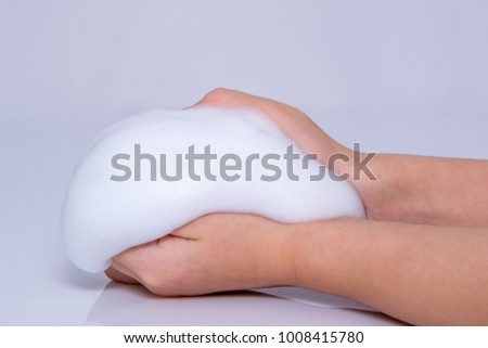 Foam of soap or shampoo on female hands. #1008415780