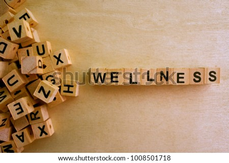 Wellness word cube on wood background ,English language learning concept #1008501718